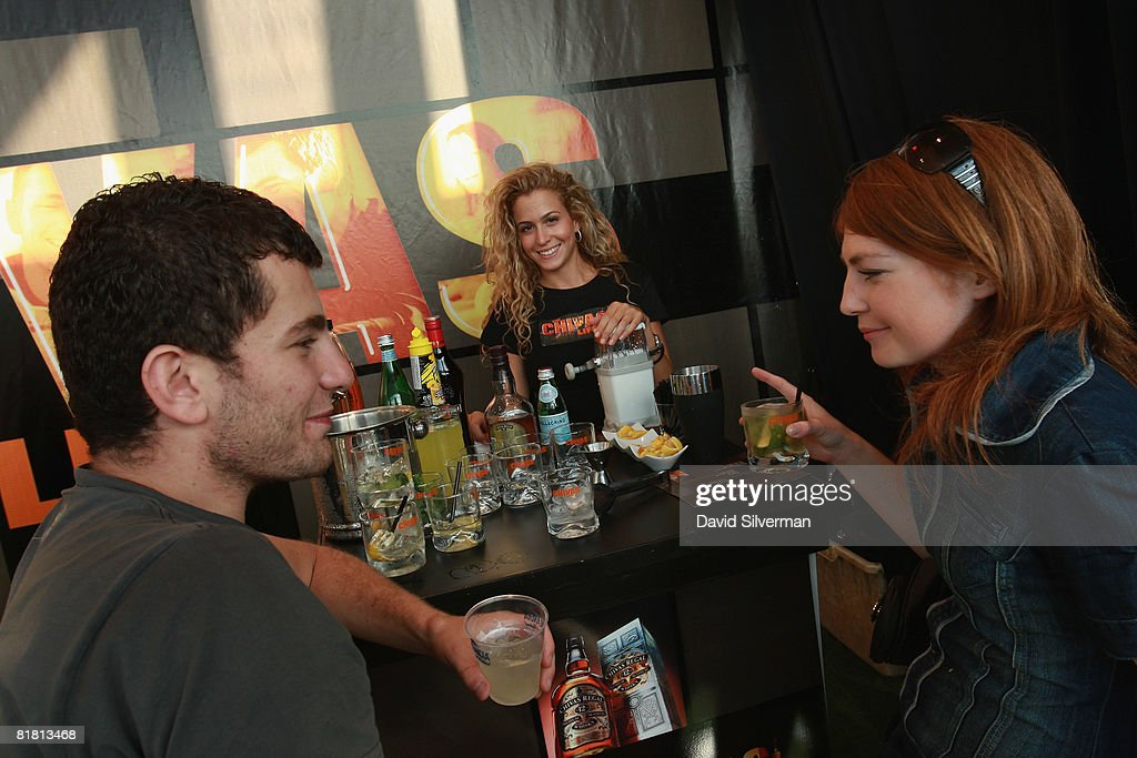 An Israeli couple enjoys Chivas Regal cocktails at the first Barman's festival held for food and drink professionals on July 1, 2008 in Tel Aviv, Israel. For three nights, Israel's leading bar and restaurant staff were treated to cocktails and testing's of some of the best imported vodkas, whiskies and beers imported into the Jewish State.