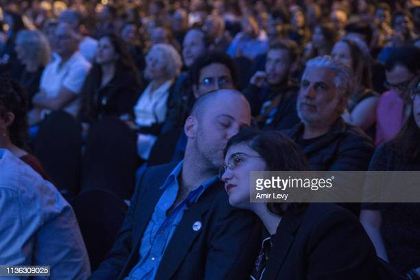 An Israeli couple react after Beresheet spacecraft fails to land safely on the moon on April 11 2019 in Tel Aviv Israel The Israeli spacecraft called...