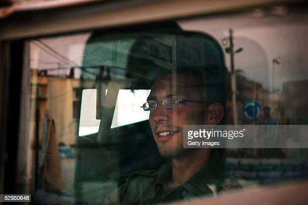 An Israeli Defense Forces solider sits inside a vehicle before a night patrol May 18 2005 in Gush Katif Gaza strip Tension has grown since ongoing...