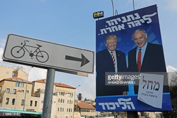 An Israeli election billboard for the Likud party showing US President Donald Trump shaking hands with Likud chairman and Prime Minister Benjamin...