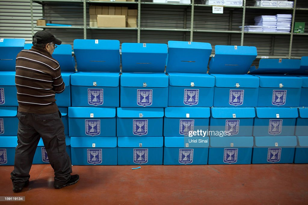 An Israeli electoral worker arranges ballot boxes at the Israeli Elections Committee headquarters on January 8, 2013 in Shoham, Israel. Israeli elections are scheduled for January 22.