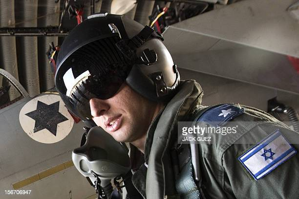An Israeli F15 Eagle fighter jet pilot poses for a picture in an Israeli Air Force Base on November 19 2012 European Union foreign ministers called...