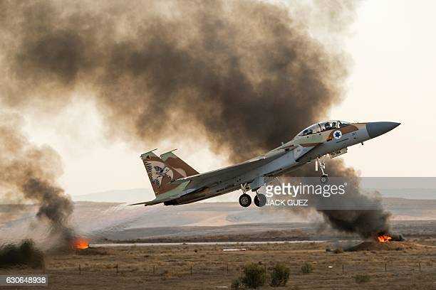 An Israeli F15 fighter jet takes off during an air show at the graduation ceremony of Israeli air force pilots at the Hatzerim base in the Negev...