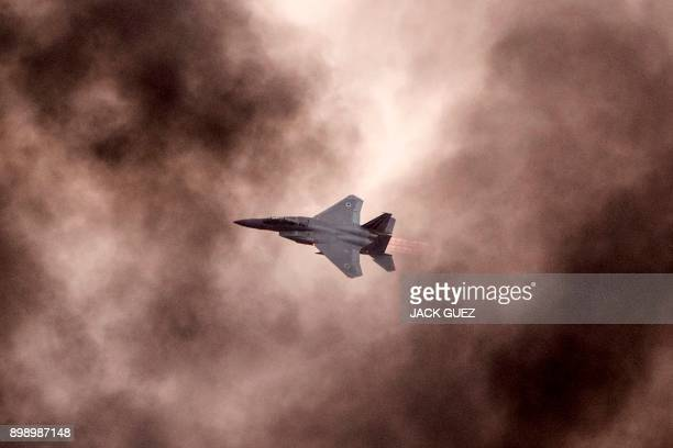 An Israeli F15 I fighter jet performs during an air show at the graduation ceremony of Israeli air force pilots at the Hatzerim Israeli Air Force...