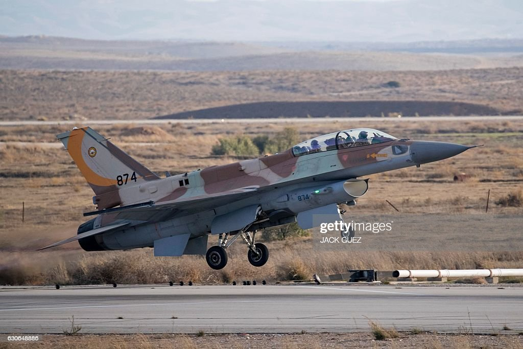 An Israeli F-16 fighter jet takes off during an air show at