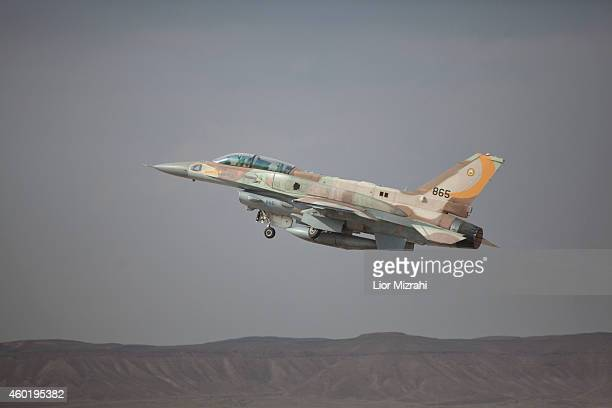 An Israeli F16 jet takes off on December 9 2014 at the Ovda airbase in the Negev Desert near Eilat southern Israel Israel and Greece concluded a...