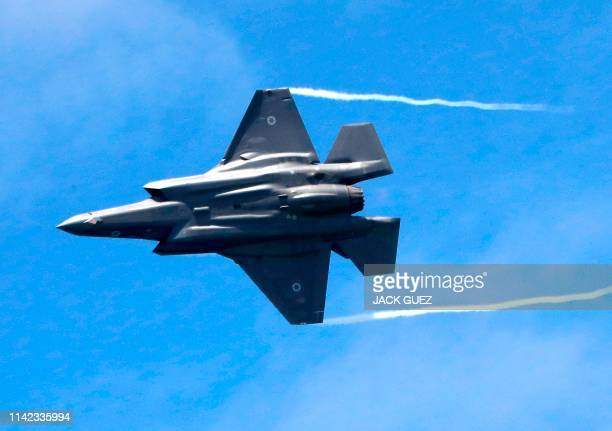 An Israeli F35 fighter jet performs during an air show over the beach in the Mediterranean coastal city of Tel Aviv on May 9 2019 as Israel marks...