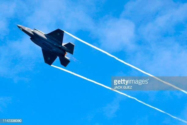 An Israeli F35 fighter jets performs during an air show over the beach in the Mediterranean coastal city of Tel Aviv on May 9 2019 as Israel marks...