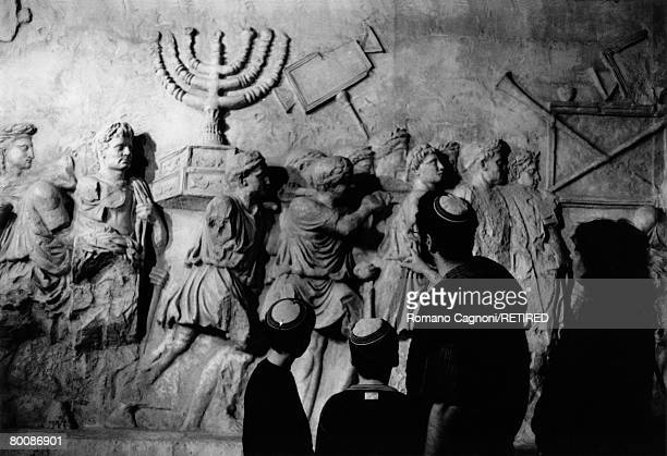 An Israeli family at the Museum of the Diaspora in Tel Aviv viewing a replica of a section of the Arch of Titus in Rome circa 1990 The carving...