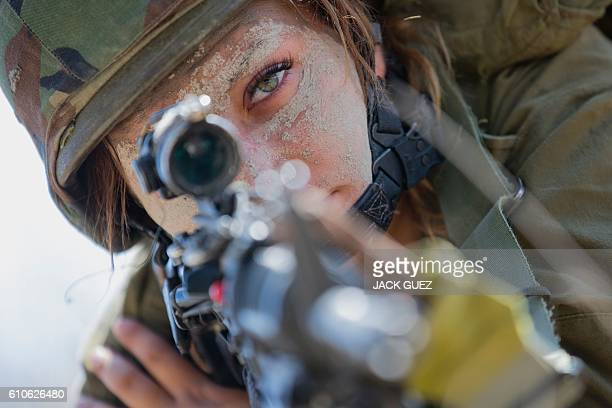 An Israeli female soldier from the mixed-gender Bardalas battalion takes part in a training at a military camp near the northern Israeli city of...