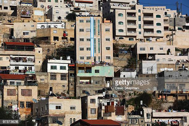 An Israeli flag decorates the right-wing Jewish settler complex of Beit Yonatan as it stands tall over the crowded Palestinian housing which typifies...