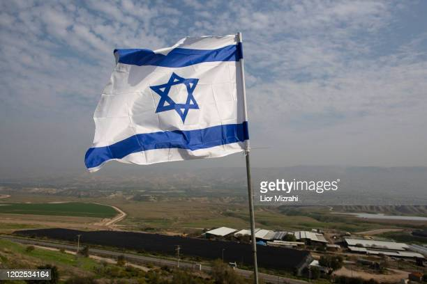 An Israeli flag flies in a Jordan Valley Jewish settlement on January 28, 2020 in Shadmot Mehola, West Bank. U.S. President Donald Trump says he's...