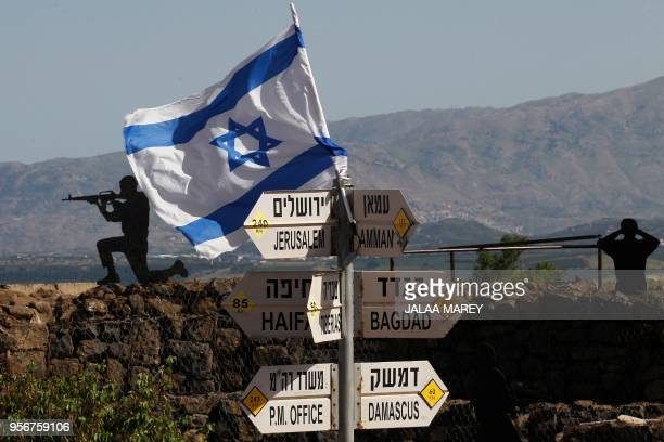 TOPSHOT An Israeli flag is seen placed on Mount Bental in the Israeliannexed Golan Heights on May 10 2018 Israel's army said today it had carried out...