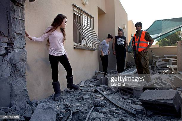 An Israeli girl stands outside her house after it was hit by a rocket fired from the Gaza Strip on November 20 2012 in Beersheba Israel Hamas...