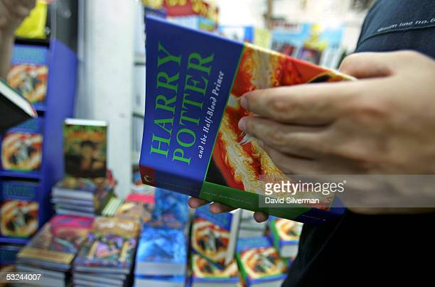 An Israeli Harry Potter reads JK Rowling's new book 'Harry Potter And The HalfBlood Prince' as it goes on sale July 16 2005 at the Tsomet Sefarim...