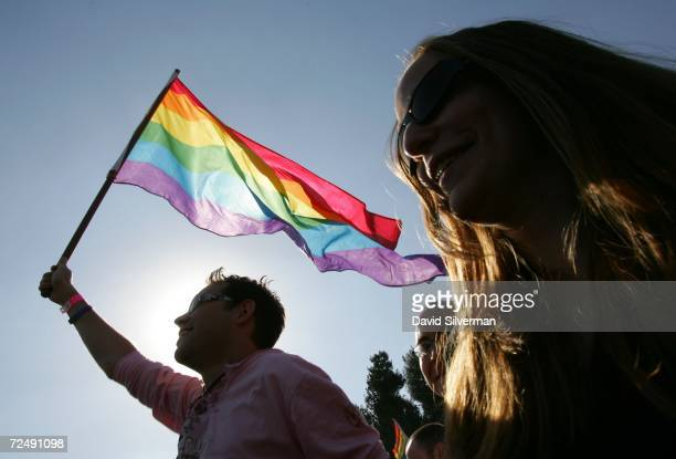 An Israeli homosexual dances with a rainbow flag at a Gay Pride rally November 10 2006 in Jerusalem About 2000 alternative lifestyle Israelis were in...