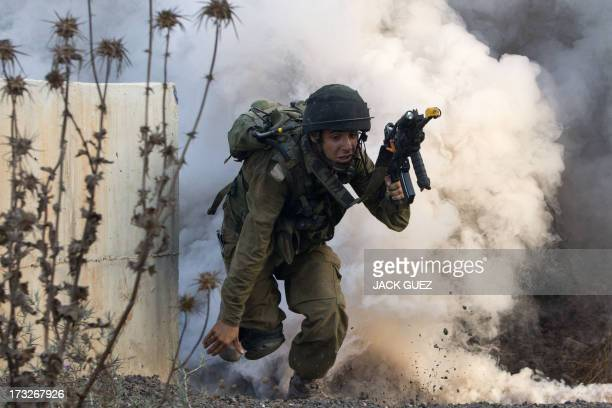 An Israeli infantry soldier from the Kfir Brigade takes part in a drill in urban warfare simulating a combat mission with Lebanon's Hezbollah at the...