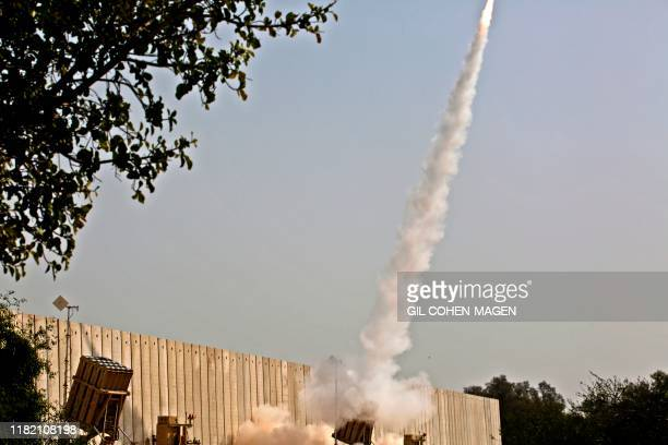 An Israeli interception missile from the Iron Dome defence system, is fired above the southern Israeli city of Ashkelon on November 13 to intercept...
