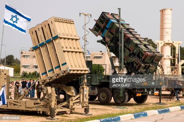 "An Israeli Iron Dome' anti-rocket system and an US 'Patriot' missile defence system are exposed during a joint Israeli-US military exercise ""Juniper..."