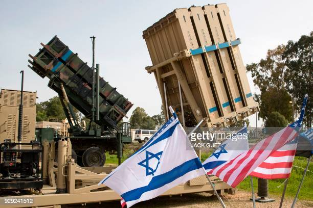 "An Israeli 'Iron Dome' anti-rocket system and an US 'Patriot' missile defence system are exposed during a joint Israeli-US military exercise ""Juniper..."