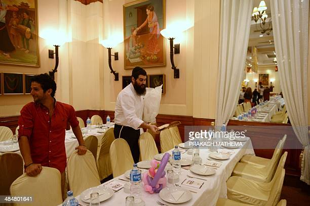 An Israeli Jewish worshipper places matzo on a table before a Passover ceremony in Kathmandu on April 14 2014 Hundreds of Jewish travellers in...