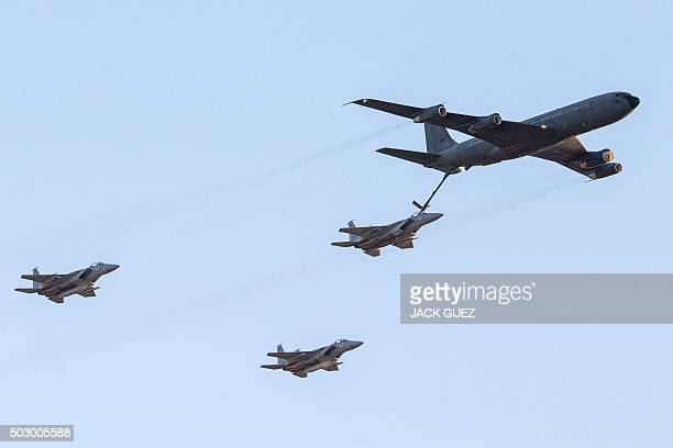 An Israeli KC135 Stratotanker Boeing 707 plane refuels an F15 fighter jet as they take part in an air show for a graduation ceremony at the Hatzerim...