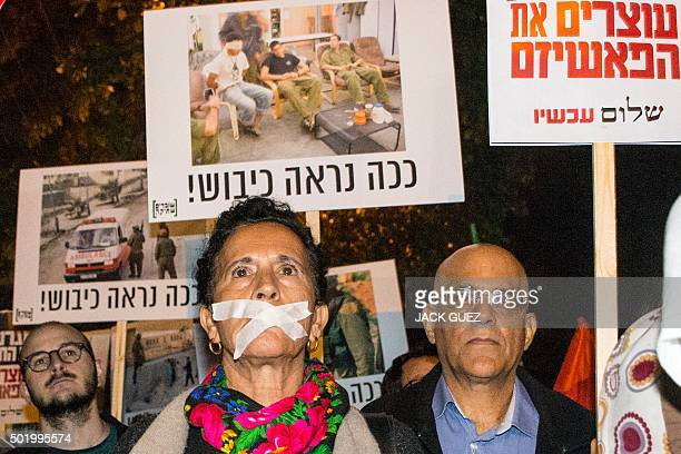 An Israeli leftwing activist with her mouth taped takes part in a 'Peace Now' march calling on Israelis to choose ''another way'' and end to the...