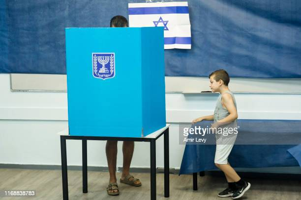 An Israeli man and his son casts his vote on September 17 2019 in Rosh Haayin Israel Israelis are heading to the polls for a second time this year...
