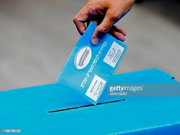 An Israeli man casts his ballot during Israel's parliamentary election at a polling station in Rosh Haayin on September 17 2019