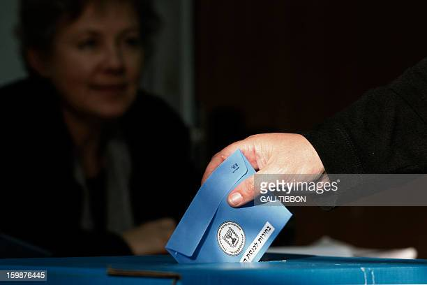An Israeli man casts his vote at a polling station in Jerusalem on January 22 2013 Israelis voted in an election likely to return Prime Minister...