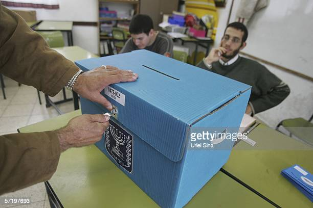 An Israeli man checks a ballot box in a polling station March 28 2006 in the village of Abu Gush near Jerusalem Israelis vote today in their 17th...