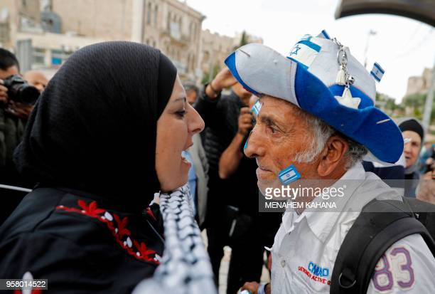 An Israeli man confronts a Palestinian woman at Damascus gate in Jerusalem on May 13 as Israeli nationalist settlers celebrate the Jerusalem Day in...