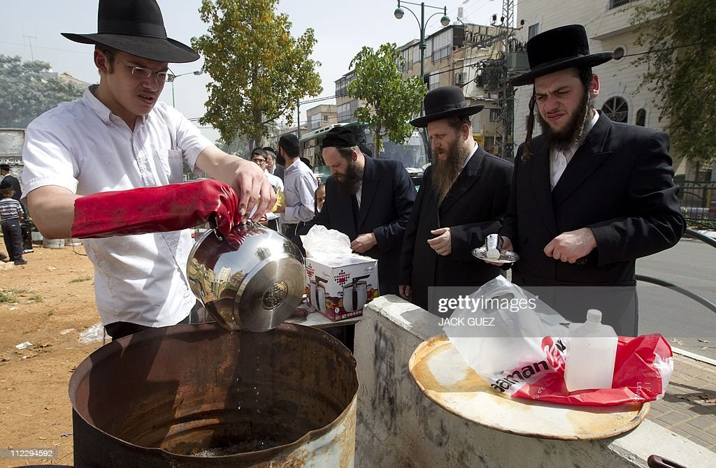 An Israeli man immerses cooking pots into boiling water to make them kosher for the Jewish festival of Pessah (Passover) in Bnei Brak near Tel Aviv, on April 18, 2011. Religious Jews throughout the world celebrate the eight-day Passover holiday, which begins on April 18, 2011, to commemorate the Israelites' exodus from Egypt some 3,500 years ago. Due to the haste with which the Jews left Egypt, the bread they had prepared for the journey did not have time to rise. To commemorate their ancestors' plight, the religious avoid eating leavened food products throughout Passover..