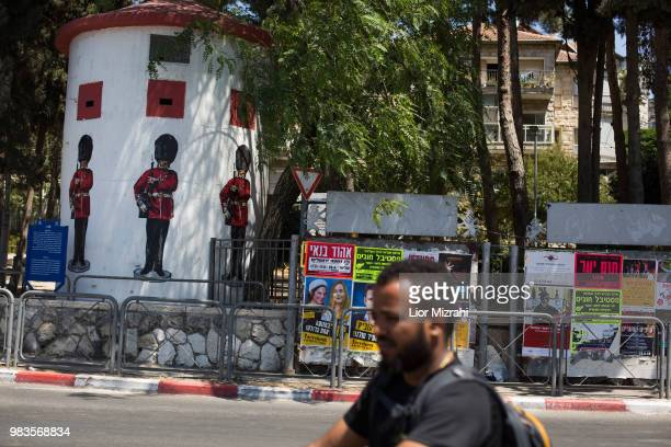 An Israeli man is seen next to an old British military Pillbox with pictures of Grenadier Guards on June 25 2018 in Jerusalem Israel Britain's Prince...