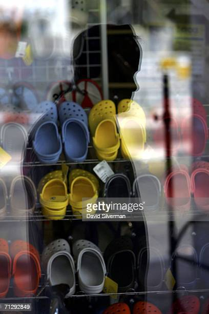 b03bcd4128a45 An Israeli man pauses to look at a window display of Crocs shoes in a shoe