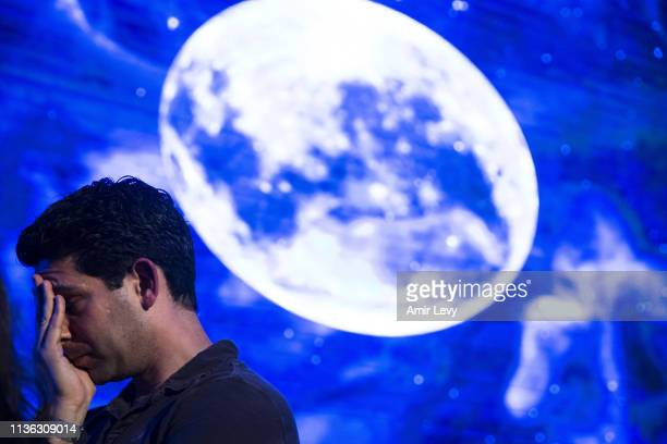 An Israeli man react after Beresheet spacecraft fails to land safely on the moon on April 11 2019 in Tel Aviv Israel The Israeli spacecraft called...