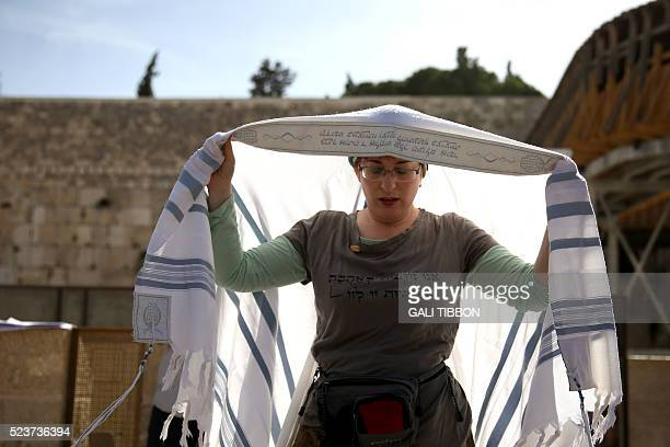 An Israeli member of the liberal Jewish religious group Women of the Wall wears a Tallit traditional Jewish prayer shawls for men as she prays at the...
