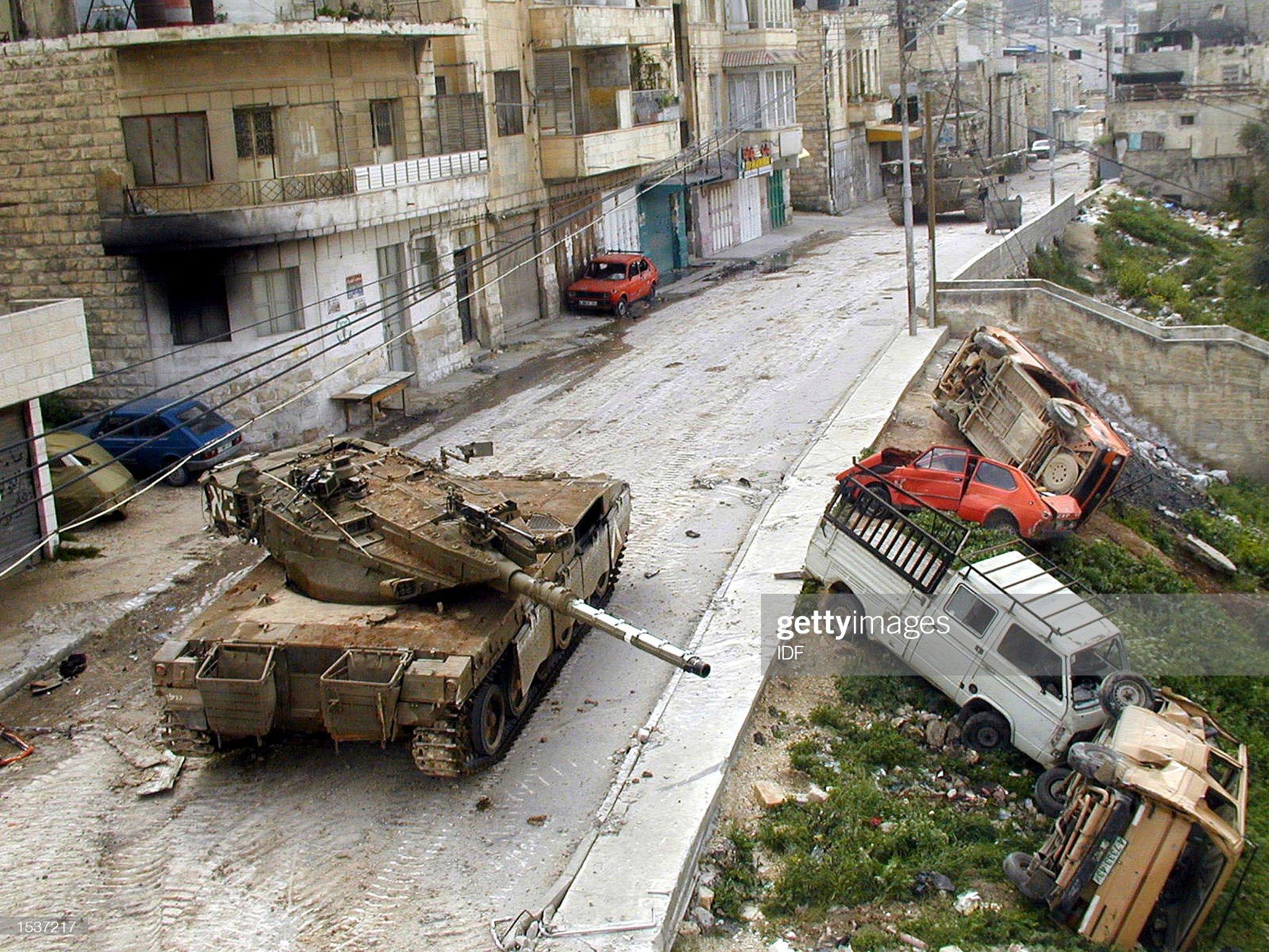 https://media.gettyimages.com/photos/an-israeli-merkava-tank-patrols-the-west-bank-town-of-jenin-april-9-picture-id1537217?s=2048x2048