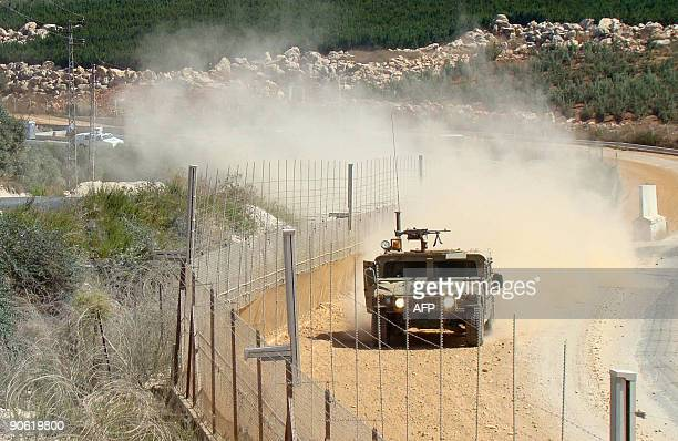 An Israeli military vehicle patrols the border with Lebanon as seen from the southern Lebanese village of Adaisseh on September 12 2009 UN...