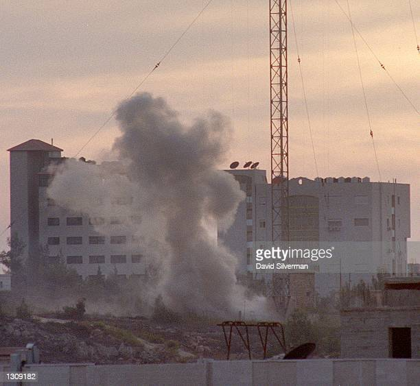 An Israeli missile explodes alongside a Palestinian Radio antenna the evening of 12 October 2000 in Ramallah the West Bank hours after a Palestinian...