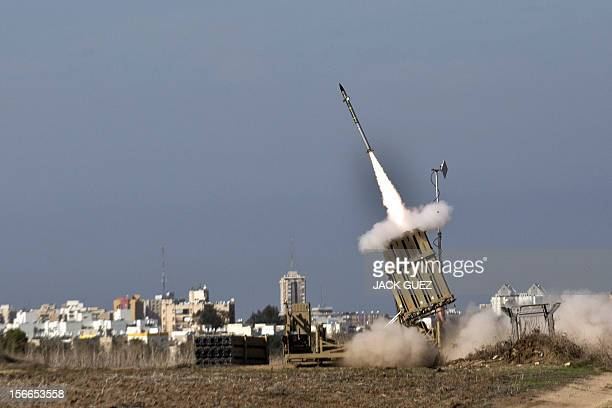 An Israeli missile is launched from the Iron Dome defence missile system, designed to intercept and destroy incoming short-range rockets and...