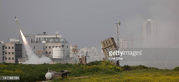 An Israeli missile is launched from the Iron Dome missile system in response to a rocket launch from the nearby Palestinian Gaza Strip, on March 12,...