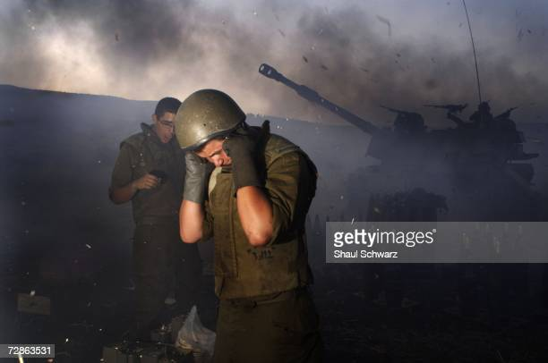 An Israeli mobile artillery unit fires towards Hezbollah targets in southern Lebanon 18 July 2006 at a military staging area along the northern...