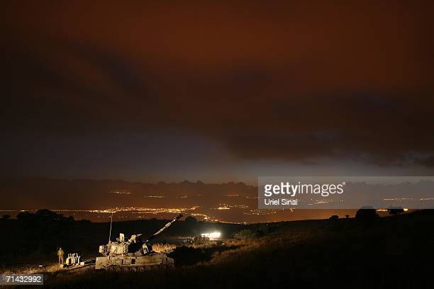 An Israeli mobile artillery unit prepares to fire 155mm shells towards Hezbollah targets in southern Lebanon July 13 at a military staging area along...