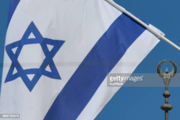 An Israeli national flag and an Islamic crescent on top of the minaret of a mosque seen inside the Old City in Jerusalem Wednesday 14 March 2018 in...