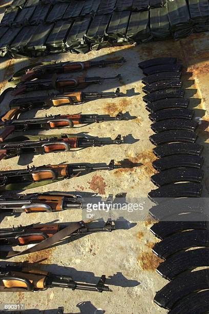 An Israeli navy handout photo shows captured AK47 assault rifles and munition clips on the deck of the captured Palestinian vessel KarineA after...