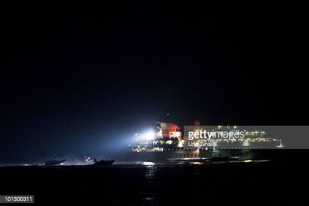 An Israeli Navy personnel board a ship as the Israeli Navy Intercepts peace boats bound for Gaza on May 31 2010 in the Mediterranean sea 70 miles...