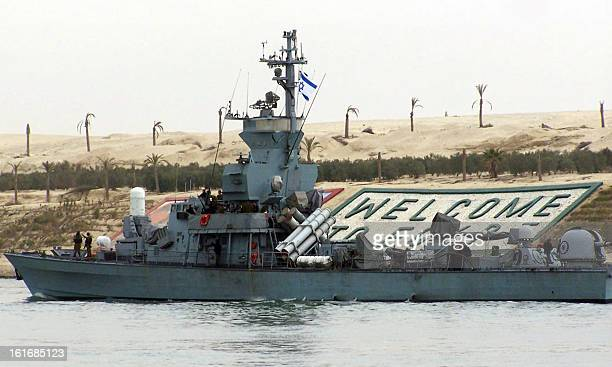 An Israeli Navy ship bearing the Israeli flag crosses the Suez canal close to the port city of Ismailia some 120 km north east of the capital Cairo...