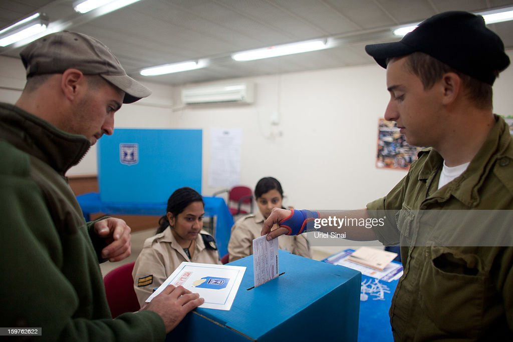 OUT] An Israeli Navy soldier casts his vote at an army Navy base on January 20, 2013 in Ashdod, Israel. Israeli soldiers have voted ahead of the Israeli general elections that will be held on January 22. The IDF votes before the rest of the country to make sure that every soldier has a chance to cast a ballot.