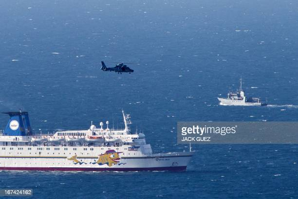 An Israeli navy vessel and helicopter search for the wreckage of a drone which was shot down by the air force off Israel's northern coast on April 25...
